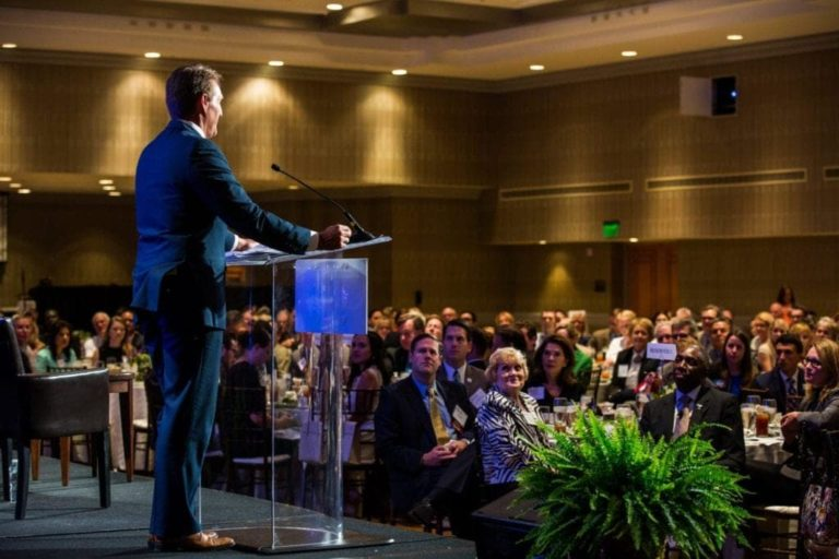 Corporate Event Photography Speaker in front of an Audience